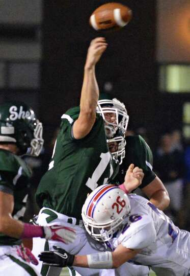 Shen's QB #12 Ryan Buss gets off a pass during Friday night's game against Saratoga High at Shenende