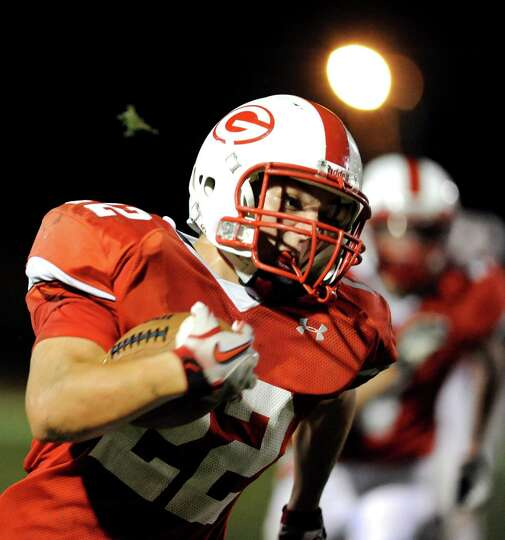 Guilderland's Zach Formica (22) carries the ball during their football game against Bethlehem on Fri