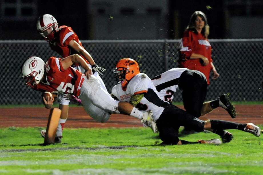 Guilderland's Stephen Polsinelli (25), left, dives into the end zone for a touchdown as Bethlehem's Joe Giacone (18) defends during their football game on Friday, Oct. 5, 2012, at Guilderland High in Guilderland, N.Y. (Cindy Schultz / Times Union) Photo: Cindy Schultz / 00019494A