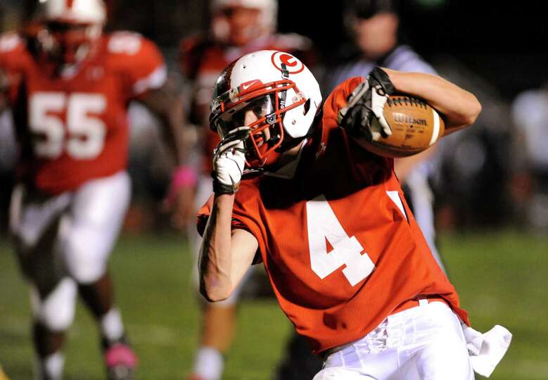 Guilderland's Jacob Smith (4) carries the ball during their football game against Bethlehem on Frida