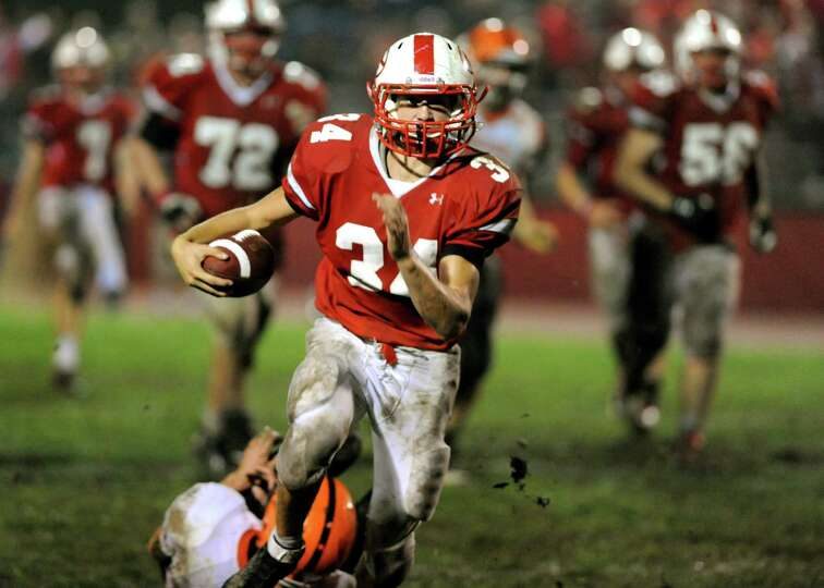 Guilderland's Joe Cornell (34) drives past Bethlehem's defense during their football game on Friday,