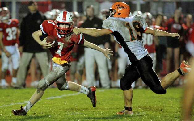 Guilderland's quarterback Frank Gallo (7), left, can't out run a sack from Bethlehem's Jason Clas (19) during their football game on Friday, Oct. 5, 2012, at Guilderland High in Guilderland, N.Y. (Cindy Schultz / Times Union) Photo: Cindy Schultz / 00019494A