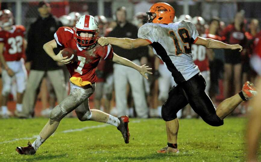 Guilderland's quarterback Frank Gallo (7), left, can't out run a sack from Bethlehem's Jason Clas (1
