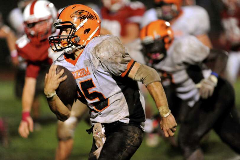 Bethlehem's Mike Graves (25) carries the ball during their football game against Guilderland on Frid
