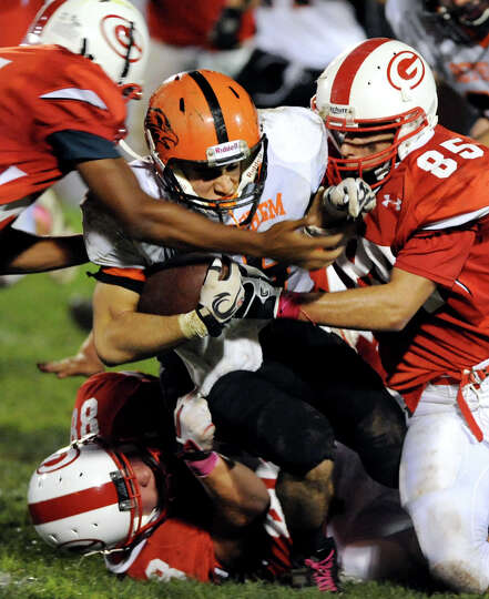 Bethlehem's Mike Graves (25), center, can't get past Guilderland's defense during their football gam