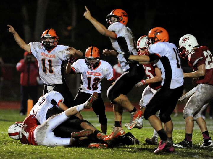 Bethlehem's defense celebrates when they recover a Guilderland fumble during their football game on