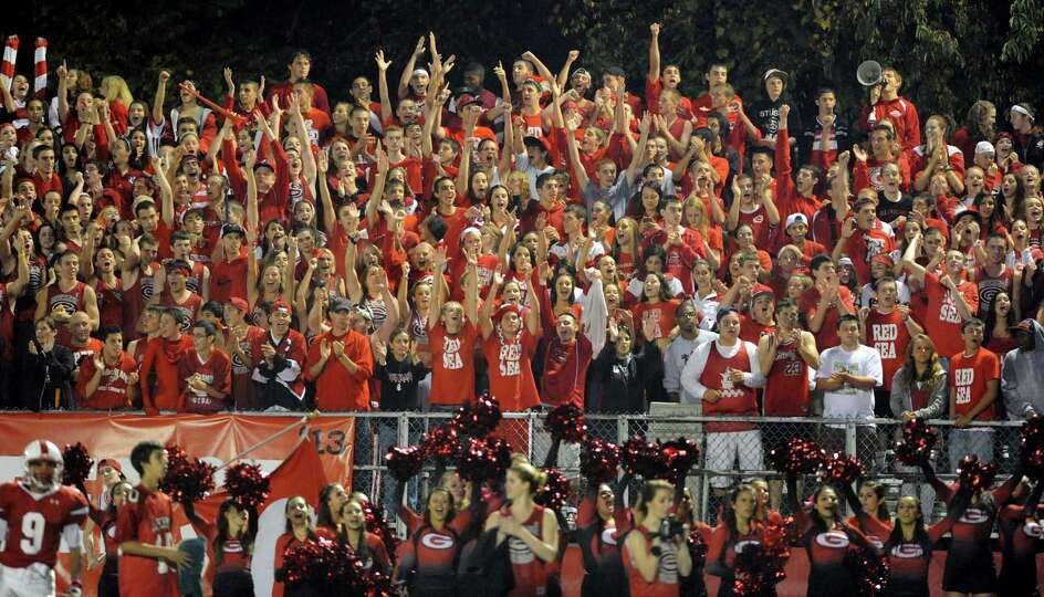 Guilderland fans cheer when their team scores to win 25-12 over Bethlehem during their football game