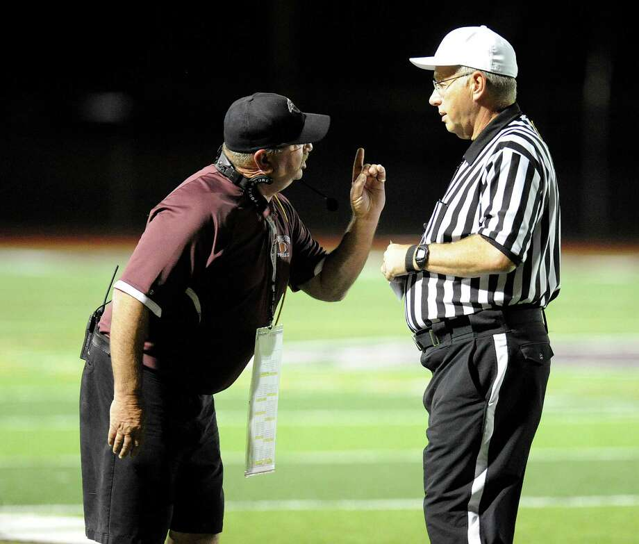 Lansingburgh head coach All McNall ,left, has words with an official during a football game against Ravena in Lansingburgh, N.Y., Friday, Oct. 5, 2012. (Hans Pennink / Special to the Times Union) High School Sports. Photo: Hans Pennink / Hans Pennink