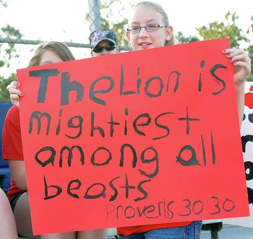 Amberly Stutts shows her support for the cheerleaders.  This was the first home football game in Kountze since the sign controversy started and since the Thursday hearing that determined the cheerleaders could or could not use their faith-based signs.  Dave Ryan/The Enterprise Photo: Dave Ryan