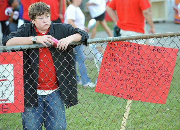 Calvin Perkins waits for the start of the game to wave his sign. This was the first home football game in Kountze since the sign controversy started and since the Thursday hearing that determined the cheerleaders could or could not use their faith-based signs.  Dave Ryan/The Enterprise Photo: Dave Ryan