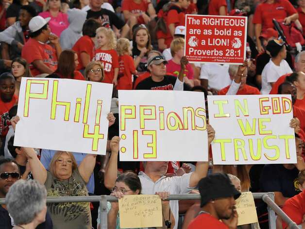 People in the stands randomly hold up their signs during the start of the game. This was the first home football game in Kountze since the sign controversy started and since the Thursday hearing that determined the cheerleaders could or could not use their faith-based signs.  Dave Ryan/The Enterprise Photo: Dave Ryan