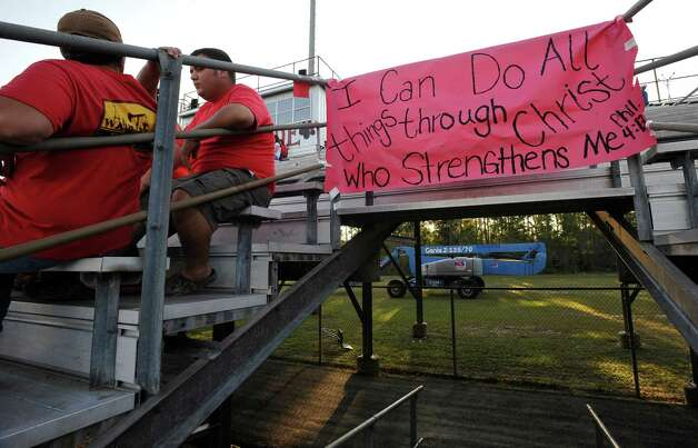A sign can be seen taped to an entrance ramp before the start of the game in support of the cheerleaders. This was the first home football game in Kountze since the sign controversy started and since the Thursday hearing that determined the cheerleaders could or could not use their faith-based signs.  Dave Ryan/The Enterprise Photo: Dave Ryan