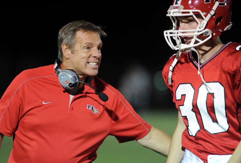 New Canaan Head Coach A.J. Albano talks to a player during Friday's game at New Canaan on October 5, 2012. Photo: Lindsay Niegelberg / Stamford Advocate