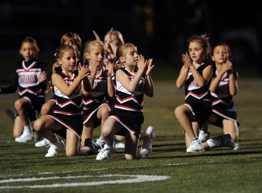 Friday's game at New Canaan on October 5, 2012. Photo: Lindsay Niegelberg / Stamford Advocate