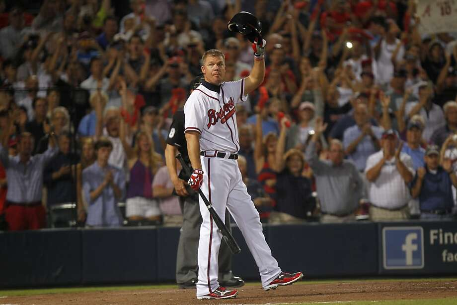 Chipper Jones lingers before his final big-league at-bat, subsequently going out with a single as the Braves made a playoff exit. Photo: John Bazemore, Associated Press