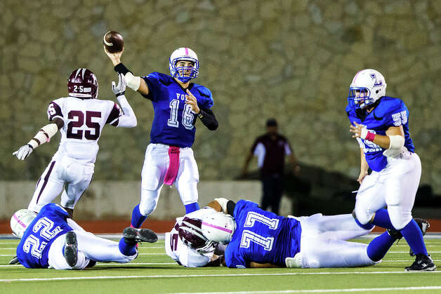 Lanier quarterback Nick Garcia gets off a pass as he stands in the pocket during their game at Alamo Stadium on Oct. 5, 2012.  MARVIN PFEIFFER/ mpfeiffer@express-news.net Photo: MARVIN PFEIFFER, Express-News / Express-News 2012