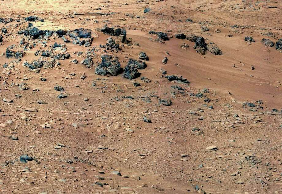 This handout image provided by NASA, taken Sept. 28, 2012,  is a mosaic of images taken by the telephoto right-eye camera of the Mast Camera before the Mars Curiosity rover arrived at Rocknest. (AP Photo/NASA) / NASA