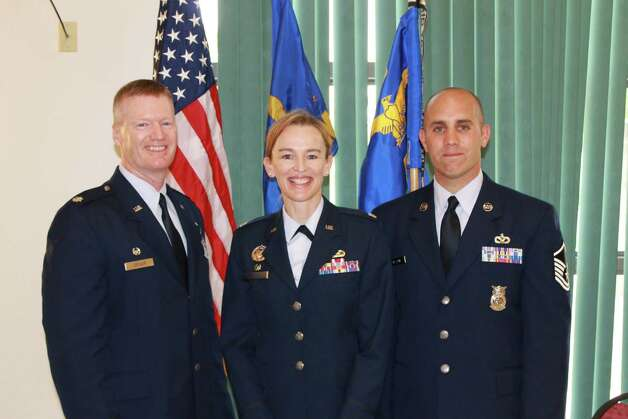 Air National Guard New York Air National Guard Lt. Col. Christine Lennard, new commander of the 109th Force Support Squadron, meets with Lt. Col. Matthew LeClair, left, outgoing commander, and Master Sgt. Michael Lazzari after a change of command ceremony at Stratton Air National Guard Base in Scotia.