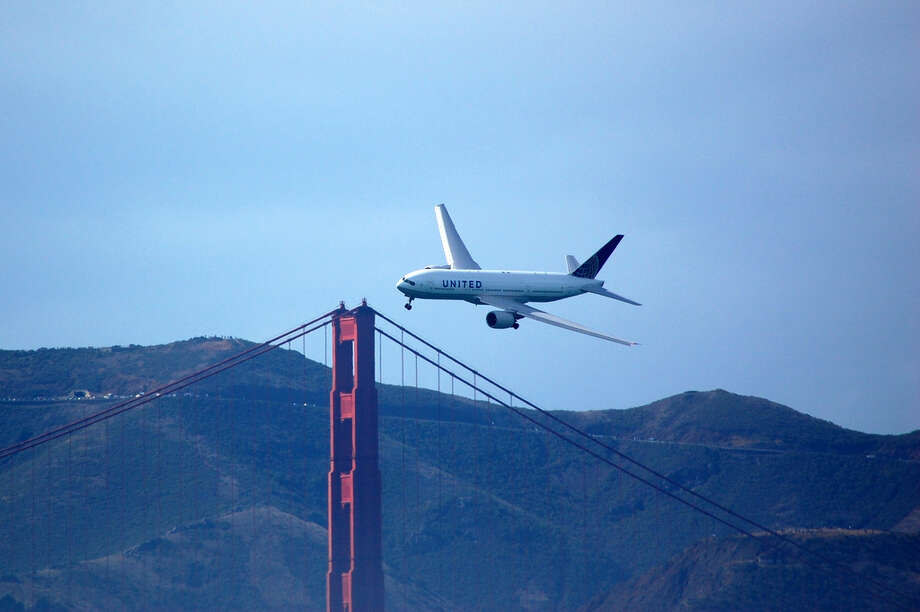"Kirby said that SFO is a United ""Crown Jewel""- here a United Boeing 777 flies over the Golden Gate Bridge during Fleet Week celebrations Photo: Down2, Down2 / Reader Photo"
