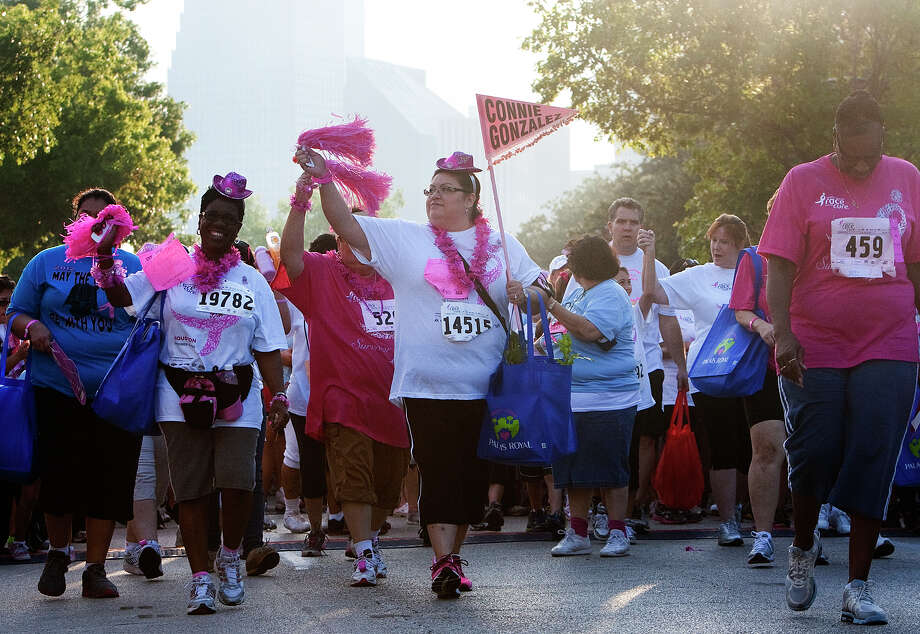Attendees begin the Komen Race for the Cure on Allen Parkway Saturday, Oct. 6, 2012, in Houston. The race is to raise awareness for breast cancer as well as celebrate breast cancer survivors. Over 20,000 people attended the race. Photo: Cody Duty, Houston Chronicle / © 2012 Houston Chronicle