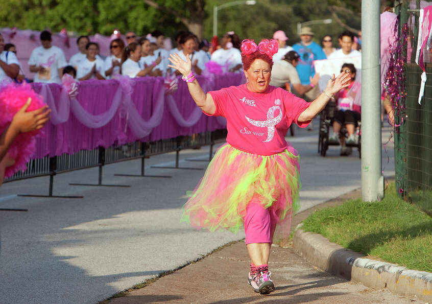 Five-year-survivor Verna Hicks celebrates while closing in on the finish line during the Komen Race