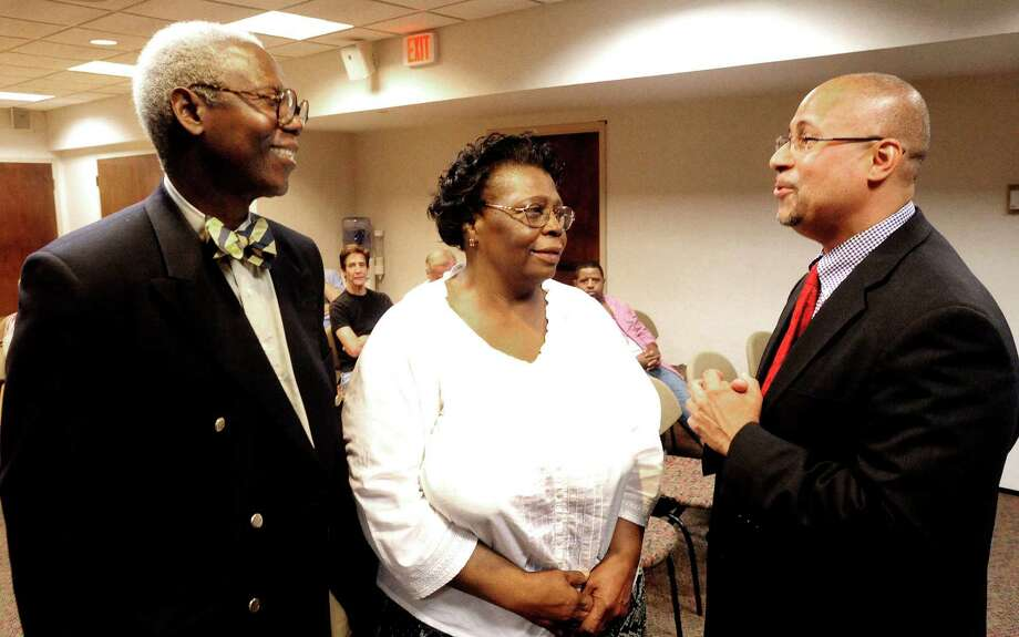 George Coleman, left, Gladys Cooper and Jason Bartlett talk before an NAACP meeting in Danbury Saturday, Oct. 6, 2012. Bartlett is running for state Senate in the 24th District. Photo: Michael Duffy / The News-Times