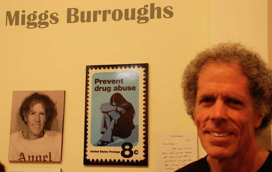 Westport artist Miggs Burroughs, with a U.S. Postal Service stamp he designed, at Friday opening of ìU.S. Postage Stamps by Westport Artistsî exhibit at Westport Historical Society. Photo: Jarret Liotta / Westport News contributed