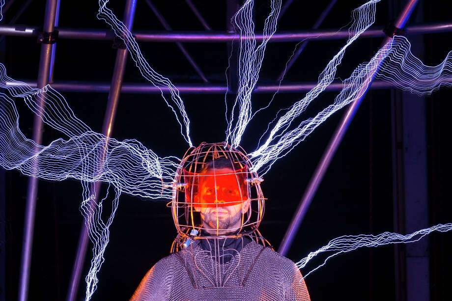 "Magician David Blaine stands inside an apparatus surrounded by a million volts of electric currents streamed by tesla coils during his 72-hour ""Electrified: 1 Million Volts Always On"" stunt on Pier 54, Friday, Oct. 5, 2012, in New York. The stunt, sponsored by Intel, is the latest of daredevil endeavors by the magician whose previous stunts included being encased in ice for over 60 hours in Times Square. (AP Photo/John Minchillo) Photo: John Minchillo"