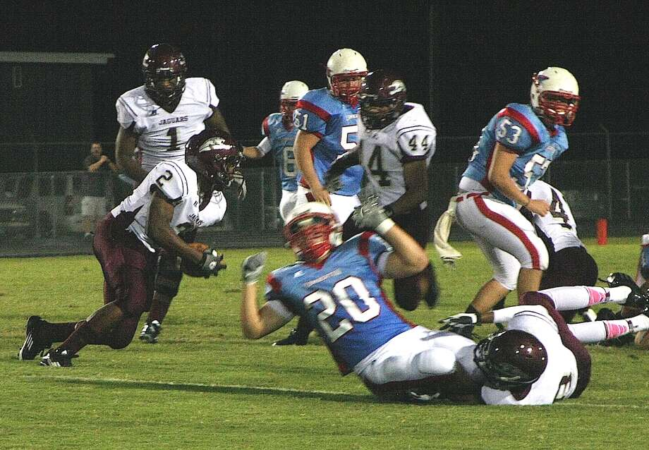The Lumberton Raiders fell to the Central Jaguars, 39-8 in their Homecoming game Friday night. Jaguar Exavier Jones picks up a fumble and returns it 43 yards for the first score of the evening. Photo: David Lisenby, Freelance