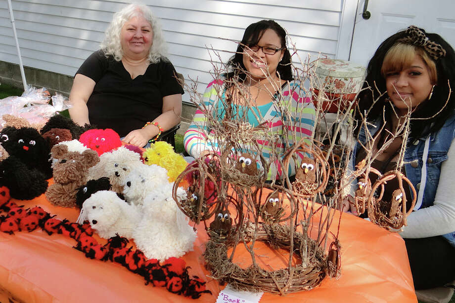 Joanne Barnes, Tania Spencer and Shelby Reese offering handmade nature-themed crafts Saturday at Our Saviour's Hill Farm Fall Fest. Photo: Mike Lauterborn / Fairfield Citizen contributed