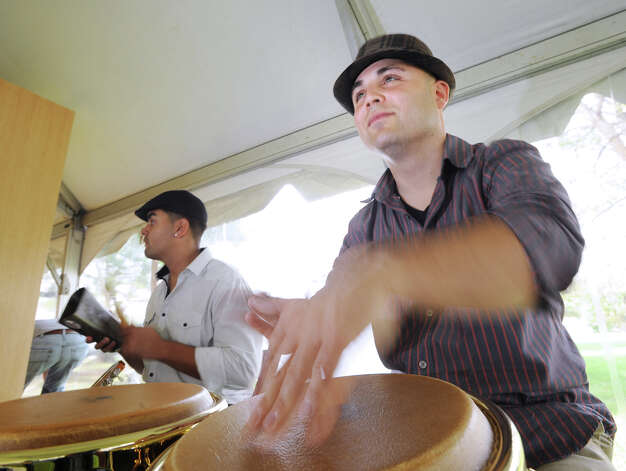 Andre Vazquez plays the congas as part of band of the Sensational Singing Chef Neil Fuentes of New Haven during the second annual Greenwich Food and Wine Festival at Roger Sherman Baldwin Park in Greenwich, Saturday, Oct. 6, 2012. The event benefits the Hole in the Wall Gang Camp, a nonprofit that runs camps for children coping with cancer, sickle cell anemia and other serious illnesses. The band is called Sonido Libre. Photo: Bob Luckey / Greenwich Time
