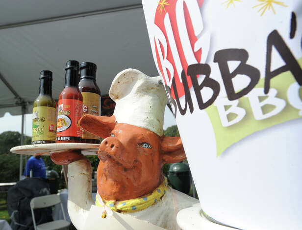 The Big Bubba's BBQ sauces display during the second annual Greenwich Food and Wine Festival at Roger Sherman Baldwin Park in Greenwich, Saturday, Oct. 6, 2012. The restaurant, at the Mohegan Sun Resort, is owned by Greenwich resident Godfrey Polistina. The event benefits the Hole in the Wall Gang Camp, a nonprofit that runs camps for children coping with cancer, sickle cell anemia and other serious illnesses. Photo: Bob Luckey / Greenwich Time