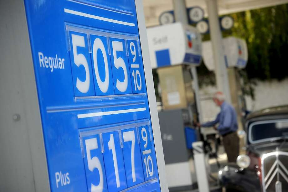 This Chevron station in Menlo Park was far from the only one in the Bay Area posting prices of more than $5 for a gallon of regular gas Friday. Photo: Noah Berger, Associated Press