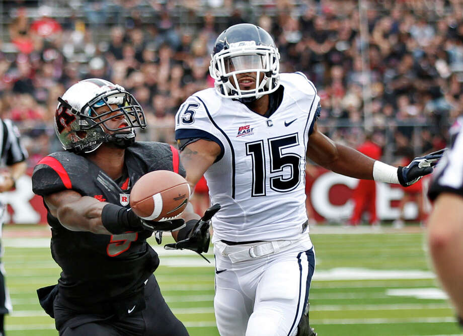 Connecticut safety Ty-Meer Brown (15) breaks up a pass intended for Rutgers wide receiver Tim Wright (5) during the first half of an NCAA college football game in Piscataway, N.J., Saturday, Oct. 6, 2012. (AP Photo/Mel Evans) Photo: Mel Evans, ASSOCIATED PRESS / Associated Press