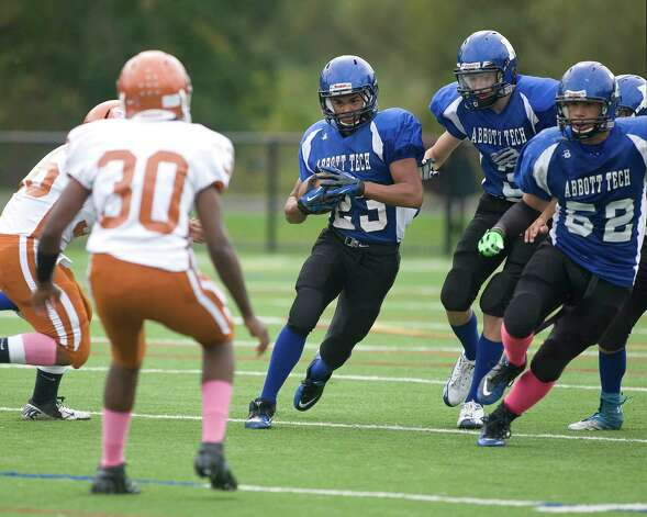 Abbott Tech's Josh Espinal (23) returns a kick against Capital Prep Saturday, Oct. 6, 2012, at Rogers Park. Photo: Barry Horn / The News-Times Freelance