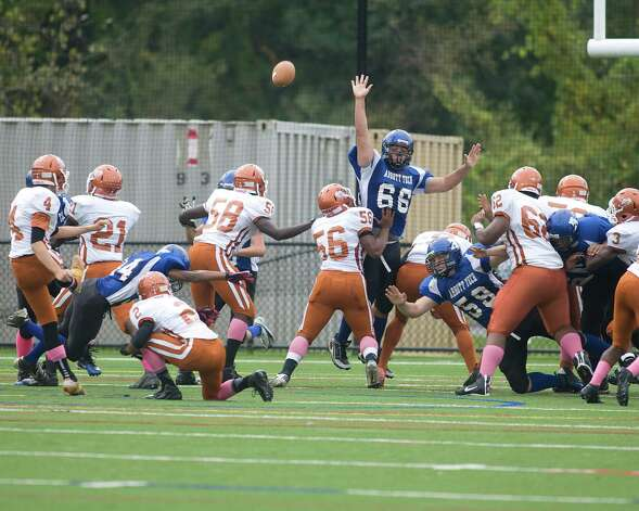 Abbott Tech's Brandon Miranda (66) leaps high trying to block a Capital Prep extra point attempt Saturday, Oct. 6, 2012, at Rogers Park. Photo: Barry Horn / The News-Times Freelance