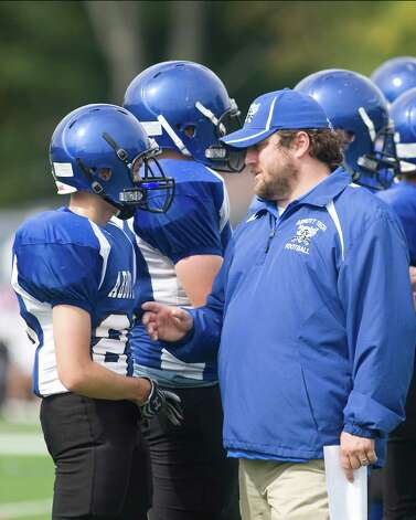 Abbott Tech head coach Chris Mascolo talks with Alex Alicia Saturday, Oct. 6, 2012, at Rogers Park. Photo: Barry Horn / The News-Times Freelance
