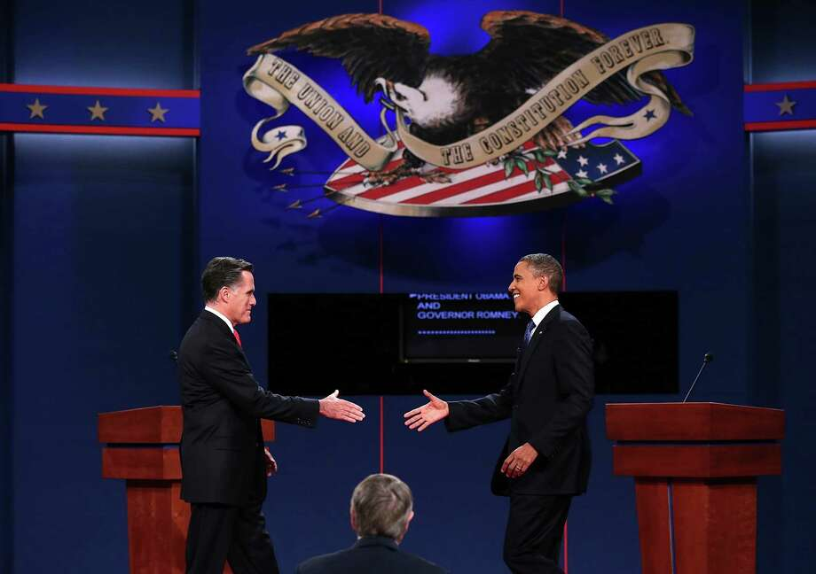 DENVER, CO - OCTOBER 03:  Democratic presidential candidate, U.S. President Barack Obama (R) reaches out to shake hands with Republican presidential candidate, former Massachusetts Gov. Mitt Romney (L) during the Presidential Debate at the University of Denver on October 3, 2012 in Denver, Colorado. The first of four debates for the 2012 Election, three Presidential and one Vice Presidential, is moderated by PBS's Jim Lehrer and focuses on domestic issues: the economy, health care, and the role of government.  (Photo by Win McNamee/Getty Images) Photo: Win McNamee, Getty Images / 2012 Getty Images