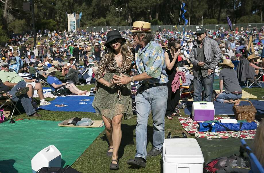 Kimberly Bell and James Belden dance to music by the World Famous Headliners who were performing on the Banjo Stage at Hardly Strictly Bluegrass in Golden Gate Park in San Francisco, Calf., on Saturday, October 6, 2012. Photo: Laura Morton, Special To The Chronicle