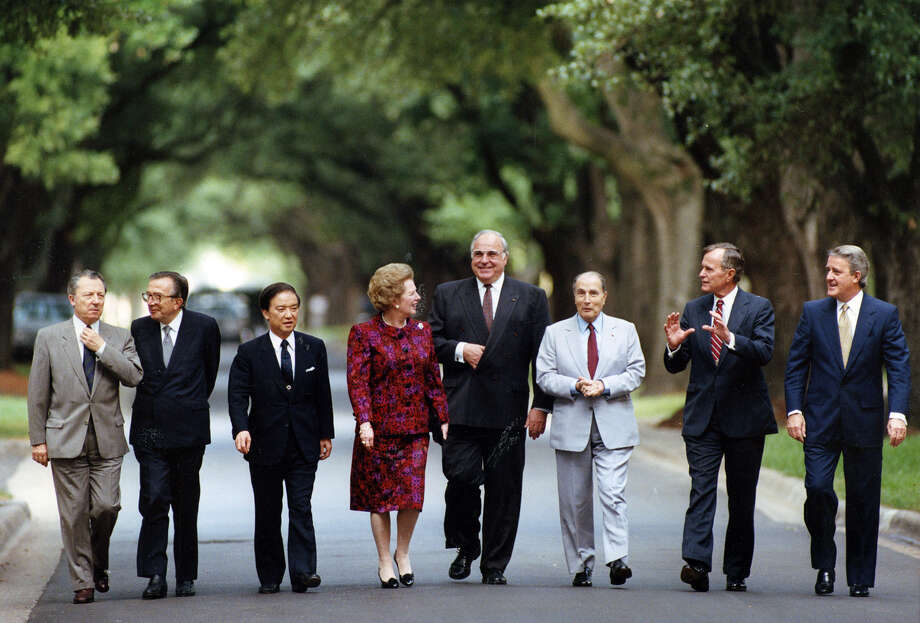 Summit leaders walk to lunch at Cohen House at Cohen House at Rice University following a morning session. (l-r) President of the European Commission, Jacques Delors; Prime Minister of Italy, Giulio Andreotti; Prime Minister of Japan, Toshiki Kaifu; Prime Mininister of the United Kingdom, Margaret Thatcher; President of France, Francoise Mitterand; Chancellor of West Germany, Helmut Kohl; US President George HW Bush and Prime minister of Canada, Brian Mulroney.  July 10, 1990. Photo: Nuri Vallbona, Houston Chronicle / Houston Post files