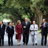 Summit leaders walk to lunch at Cohen House at Cohen House at Rice University following a morning session. (l-r) President of the European Commission, Jacques Delors; Prime Minister of Italy, Giulio Andreotti; Prime Minister of Japan, Toshiki Kaifu; Prime Mininister of the United Kingdom, Margaret Thatcher; President of France, Francoise Mitterand; Chancellor of West Germany, Helmut Kohl; US President George HW Bush and Prime minister of Canada, Brian Mulroney.  July 10, 1990.