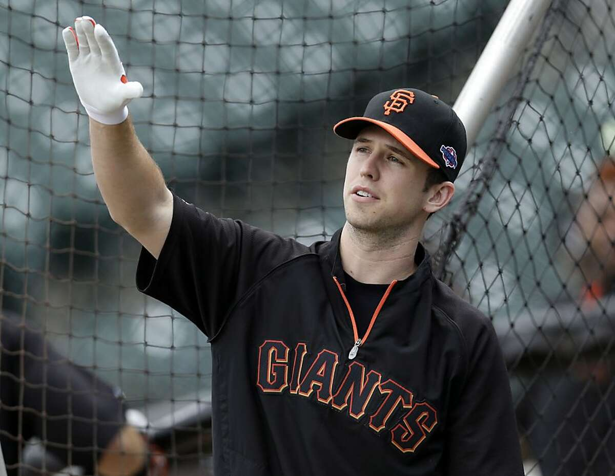 San Francisco Giants' Buster Posey gestures during baseball practice, Friday, Oct. 5, 2012 in San Francisco. The Giants host the Cincinnati Reds in Game 1 of the National League division series on Saturday. (AP Photo/Marcio Jose Sanchez)
