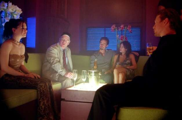 "Spike Lee's ""25th Hour."" From left: Anna Paquin, Philip Seymour Hoffman, Norton, Rosario Dawson and Barry Pepper."