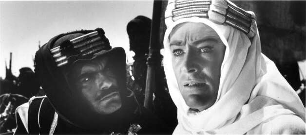 "T.E. Lawrence (Peter O'Toole, r.) and Sheik Ali ibn el Kharish (Omar Sharif) share the dangers posed by the desert and the Turks in director David Lean's ""Lawrence of Arabia."" (jtyler) (Columbia Pictures 1962)"