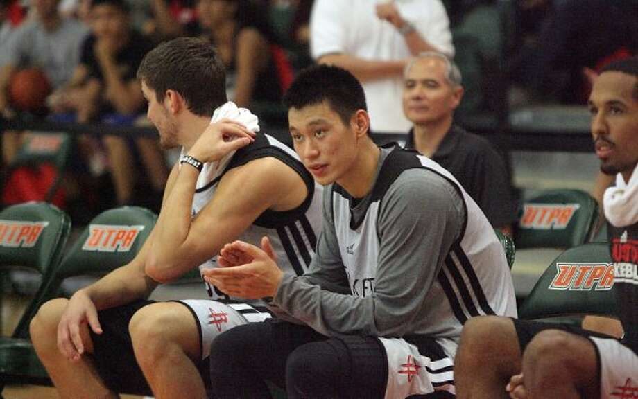 Rockets guard Jeremy Lin applauds his teammates during a scrimmage. (Delcia Lopez / Associated Press/The Monitor)