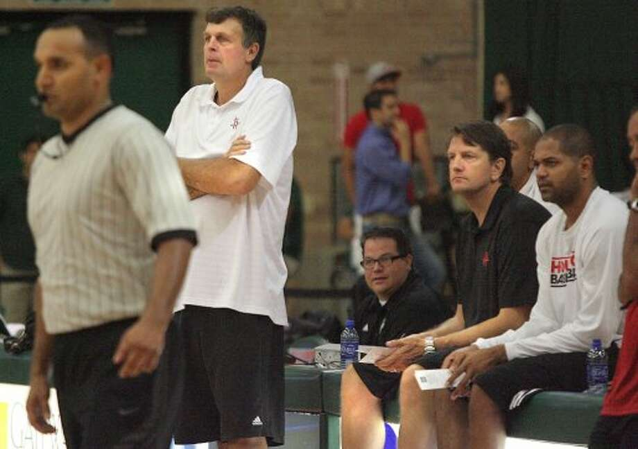 Rockets coach Kevin McHale and assistant Chris Finch watch the Rockets during a practice. (Delcia Lopez / Associated Press/The Monitor)