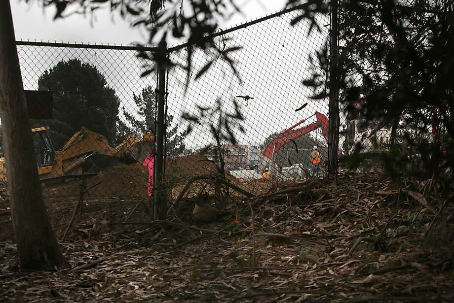 From her backyard in Bayview, Kathy Looper can see the site where Willie Brown Jr. prep school is being torn down. Photo: Liz Hafalia, The Chronicle