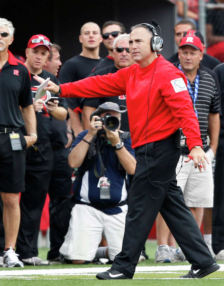 Rutgers head coach Kyle Flood signals to his players from the sidelines during the second half of an NCAA college football game against Connecticut in Piscataway, N.J., Saturday, Oct. 6, 2012. Rutgers won 19-3. (AP Photo/Mel Evans) Photo: Mel Evans, Associated Press / AP