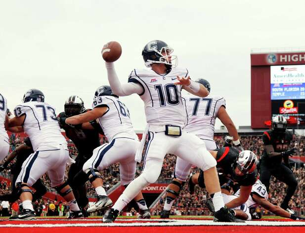 Connecticut quarterback Chandler Whitmer (10) throws a pass during the second half of an NCAA college football game against Rutgers in Piscataway, N.J., Saturday, Oct. 6, 2012. Rutgers won 19-3. (AP Photo/Mel Evans) Photo: Mel Evans, Associated Press / AP