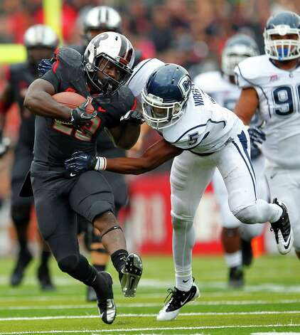 PISCATAWAY, NJ - OCTOBER 6: Running back Jawan Jamison #23 of the Rutgers Scarlet Knights fights off Blidi Wreh-Wilson #5 of the Connecticut Huskies during the second half in a game at High Point Solutions Stadium on October 6, 2012 in Piscataway, New Jersey. Rutgers defeated Connecticut 19-3. (Photo by Rich Schultz /Getty Images) Photo: Rich Schultz, Getty Images / 2012 Getty Images